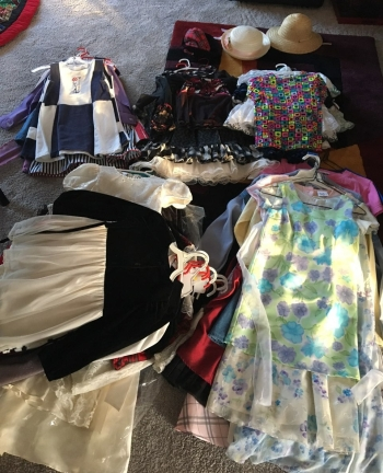 pile of female children's dresses